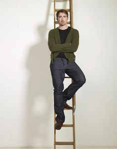 what is it about a man a cardigan??  Oh and the ladder.... the possibilities are endless??? but at that height what does he need a ladder for?