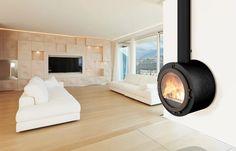 Poêle à bois aux lignes généreuses telles celles d'une cheminée, Calienta vous surprendra par ses performances et son design. Fabrication 100 % française.