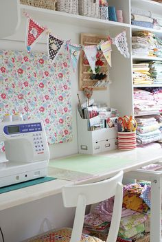 sewing nook ideas for the girl. Love the banner and the fabric pin board.