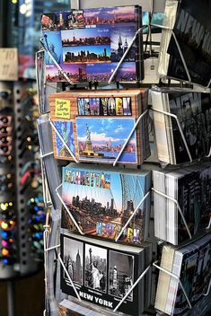 Post Cards From NYC. Photography by Andrea Rea. A street view of a typical souvenir shop in Manhattan with New York City post cards for sale. Original work available as framed print, canvas, greeting card and more only on Fine Art America and Pixels.com. https://andrea-rea.pixels.com/