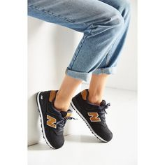 New Balance 574 Lux Sneaker ($60) ❤ liked on Polyvore featuring shoes, sneakers, black, retro sneakers, new balance sneakers, grip trainer, retro shoes and new balance footwear