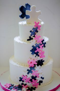 They fit!  Puzzle pieces to signify the couples matching tattoos. - wedding cake