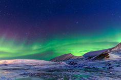 Aurora Borealis along the sky of Svalbard, Norway