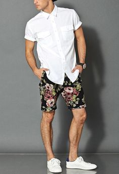 Black Floral Shorts styled with White Shirt and a pair of White Sneakers