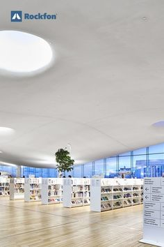 Rockfon® Mono® Acoustic played a central architectural feature to create a unique place for readers at the Oodi library in Helsinki, Finland. A true bibliophile paradise wrapped in an acoustic cocoon that curves and bends resembling the sky inviting visitors to escape the city's hustle and bustle and unwind with a great book in a biophilic environment. #SoundsBeautiful #Rockfon #acoustic #inspiration #acousticdesign #library #design #acousticmaterial #nordic #ceilingdesign #natural #material Ceiling Design, Wall Design, Acoustic Ceiling Tiles, Acoustic Design, Central Library, Meeting Place, Architectural Features, Visual Comfort, Helsinki