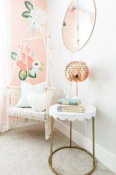 Floral wall girls bedroom with hanging chair swing. Boho style! See the whole tour