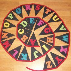 Alphabet Bunting Banner Rainbow Fabric ABC Handmade. £35.00, via Etsy.