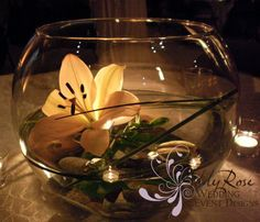 Large bowls with lilies, bear grass, floating candle & rocks by Addy Rose / Best Fresno Flowers