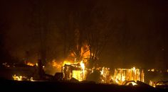 Photo Gallery: Pateros on Thursday night during firestorm - Gallery WORLD PHOTO/MIKE BONNICKSEN