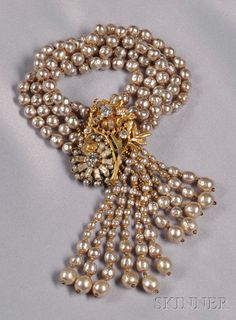 Vintage Imitation Baroque Pearl Tassel Bracelet, Miriam Haskell, designed as five strands of imitation baroque pearls, the floral-form clasp set with circular and baguette-cut strass, and suspending a fringe of imitation baroque pearls, lg. 7 1/2 in., signed.