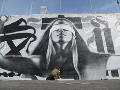 El Mac: This is a mural I just painted with my friends Kofie and Retna near Vine and Sunset in Hollywood, CA. It was commissioned by Yosi Sergant for the Manifest Equality show. I based this on a reference photo I took, which in turn was based on a drawing of Lady Justice by Edwin Abbey from the late 1800s. Retna painted the large letters in the background, Kofie painted the designs around the hands and borders on each end of the mural, and I painted the figure. The wall is about 100 ft.
