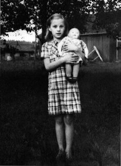 """Girl with her Martha doll """"Sisko"""", 1940. This doll was sold in three names; Pipsa, Sisko (Sister) and Veli (Brother)."""