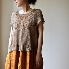 653cc47028757e Ranunculus is a round yoke pullover with lace and textured stitches. Sweater  Knitting Patterns