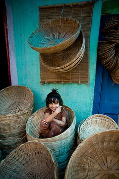Girl in a basket at Russell Market in Bangalore