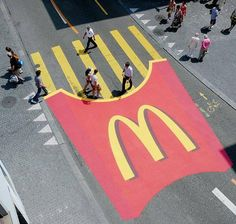 Just another example of how advertising is everywhere. How corporations like McDonald's are getting stronger because of their smart product placements. They made a cross walk that reminded no one about food to think only about their food.