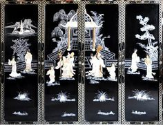 Set of 4 Chinese black lacquer art panels with relief artwork