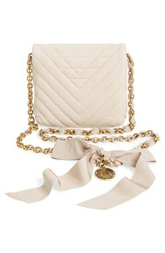 The ribbon bow on this Lanvin quilted leather crossbody bag is beautiful.