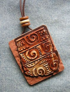"Might use Adinkra stamps for details/texture...Belize pendant detail by Pati B. - She says, ""Pendant 2 x 2 1/2  Polymer Clay, wooden beads; antiqued, lightly...  Might use Adinkra stamps for details/texture...Belize pendant detail by Pati B. - She says, ""Pendant 2 x 2 1/2  Polymer Clay, wooden beads; antiqued, lightly buffed & waxed."