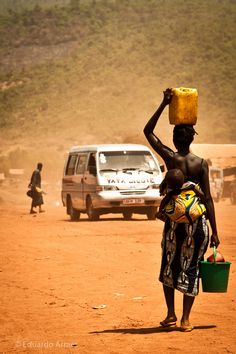 Woman carrying water and child, Sierra Leone - WATER
