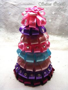 Charming christmas tree, decorated with pink, purple and turquoise satin ribbon Purple Christmas, Christmas Time, Merry Christmas, Xmas, Christmas Stuff, Christmas Ideas, Christmas Decorations, Christmas Ornaments, Holiday Decor