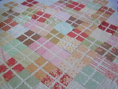 Simple blocks quilt - would be cute with plaid . Would look like argyle