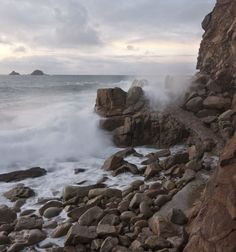 Incoming tide at sunset - Porth Nanven beach on the Cornwall coast