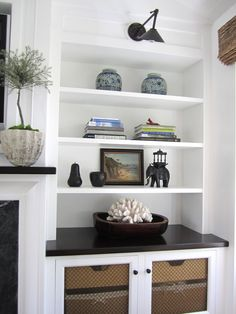 I have two of  these almost exact shelves connected to my fireplace.. And i need help decorating !