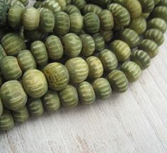 Uneven puffy rondelle  Bone beads Greencarved bone by yukidesigns, $3.25