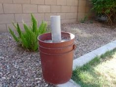 diy umbrella stand: concrete in 5 gal bucket weighs about 50-60lbs