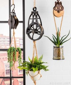Put an industrial spin on your green thumb endeavors by hanging foliage from stylish pulleys. No green thumb? Go for faux! Vintage Industrial Decor, Rustic Decor, Farmhouse Decor, Industrial Interiors, Industrial Office, Industrial Lighting, Modern Industrial, Vintage Metal, Industrial Design