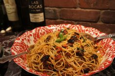 Meatless Monday Meal: Spaghetti with porcini mushrooms, roasted grape tomatoes, garlic, fresh basil, and fresh grated Reggiano Parmesan cheese. Totally meatless, and incredibly delicious! (Kim Beall Kortenbach)