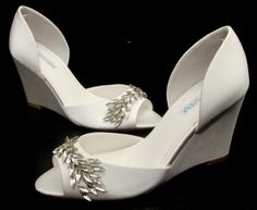 "We love the sexy wedge and bit of bling on ""Winter"" by #DavidTutera ! #WeddingShoeInspirations"