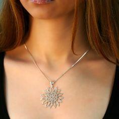 Sterling silver pendant, sun.