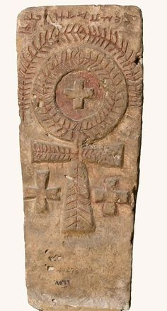"""Inv. No. 8566 Sandstone El-Badary (Assiut), 6th century  This gravestone is carved with a looped cross, formerly the Egyptian """"Ankh"""" (the Pharaonic key of life). It is decorated with a wreath-like pattern and flanked by Greek crosses. Another Greek cross is set inside the loop which is surrounded by a palm branch, which symbolises victory.   .:."""