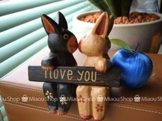 kissing rabbits (wooden doll)