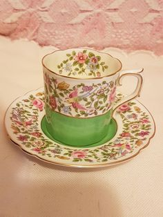 Pretty Royal Crown Derby coffee can cup and saucer green floral and exotic bird pattern A413 by AgoodvintageBoutique on Etsy