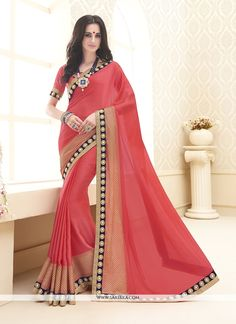 We have ensemble a symphony of enchanting piece to restyle your senses. Make the heads flip as soon as you costume up with this charming orange chiffon satin designer saree. The brilliant dress create...