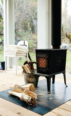 Wood fire stove in front of window