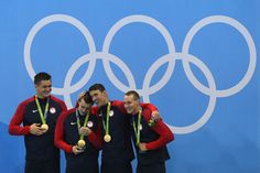 Gold medalists Nathan Adrian, Ryan Held, Michael Phelps and Caeleb Dressell of the United States celebrate on the podium during the medal ceremony for the Final of the Men's 4 x 100m Freestyle Relay on Day 2 of the Rio 2016 Olympic Games at the Olympic Aquatics Stadium on August 7, 2016 in Rio de Janeiro, Brazil.