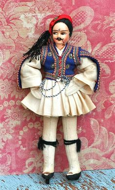 This is a charming Greek doll in wonderful shape. The doll is a Tsolia Doll, a male Greek Folk Dancer in his traditional costume complete with a red Fez (hat). Mostly felt with hand painted features and wired arms and legs. Culture Day, Greek Culture, Greek Design, New Dolls, My Favorite Image, Ancient Greece, International Fashion, Traditional Dresses, Folk Clothing