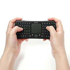 iRainy Mini Wireless Bluetooth Keyboard Handheld With Touch pad - Could be good for people that have a hard time typing with all of their fingers but are able to type with thumbs