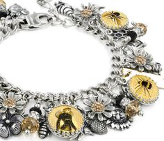 My charm bracelet shop has a large selection of silver charm bracelets, bumble bee charm bracelets,Queen Bee jewelry, as well as personalized and inspirational jewelry. Looking for something original? Shop my Etsy store!  Blackberry Designs Jewelry© Fine Jewelry Treasured for a Lifetime™  *Created with: *316L Stainless Steel, *Sterling Silver, *USA Cast Pewter, *Swarovski Crystals *No plated materials, *No Tibetan charms or materials *Will never turn color  This beautiful The Queen Bee…