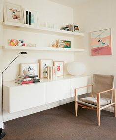 White wall unit with soft pink and brown tones in the room