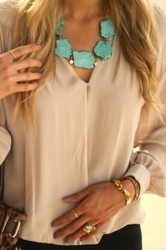 Turquoise statement necklace with dress and golden bracelet