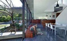 Dining to kitchen. Indooroopilly residence by Kieron Gait Architects.