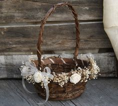 I love this darling rustic flower girl basket! The weaving of twine and vines make it a unique little basket for a rustic country or barn