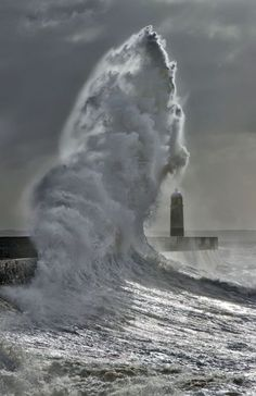 Lighthouse and wave