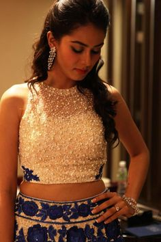 The stunning wedding reception look for the new Mrs Shahid Kapoor! Mira Rajput glitters in her ivory and royal blue Manish Malhotra lehenga - Nirav Modi jewels - no dupatta - oversized flowers - modern Indian bride - Indian wedding reception - Celebrity wedding - Bollywood wedding #thecrimsonbride