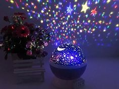 """This rotating cosmos night <a href=""""http://amzn.to/23VZ9nA"""" target=""""_blank"""">lamp</a> that'll transform your room into an intergalactic fantasy world."""