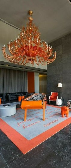 Orange Home Decor, Orange House, Chandelier, Sofa, Ceiling Lights, Candelabra, Settee, Chandeliers, Couch